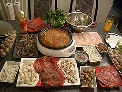 hot pot-raw meats ready to be cooked