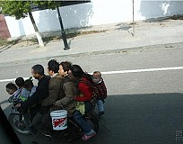 A Family of 8 on a single motorcycle